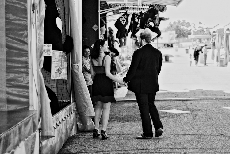 couple walking around fair during engagement session