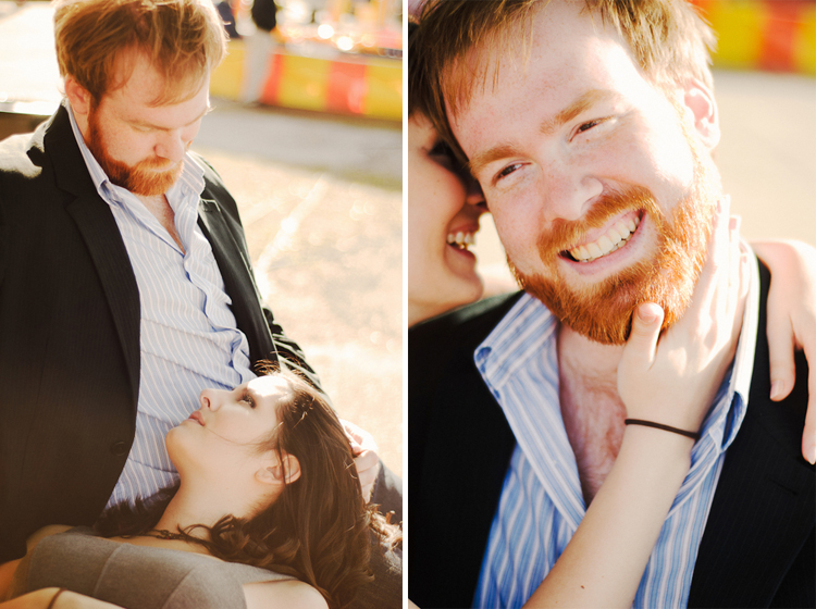 couple kissing on a bench engagement session