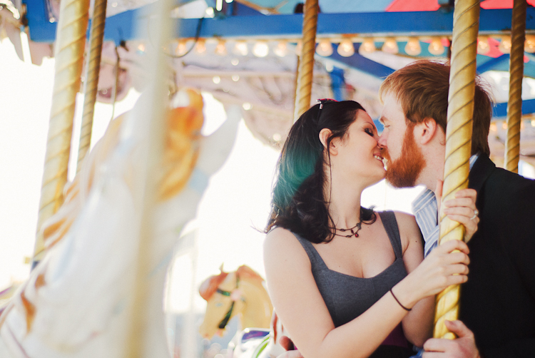 kissing on a carnival ride engagement session