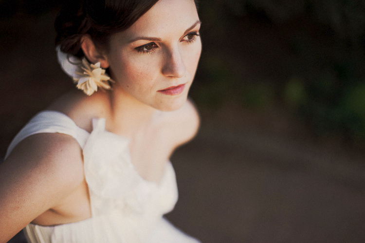 bride with flower in her hair and dress by Shirin Askari
