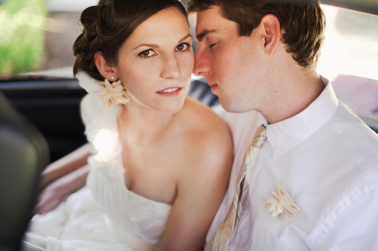 bride and groom sitting in car at hotel saint ceclia in austin tx