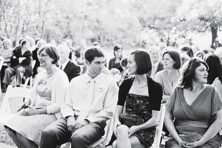 black and white photo of guests sitting at ceremony mercury hall