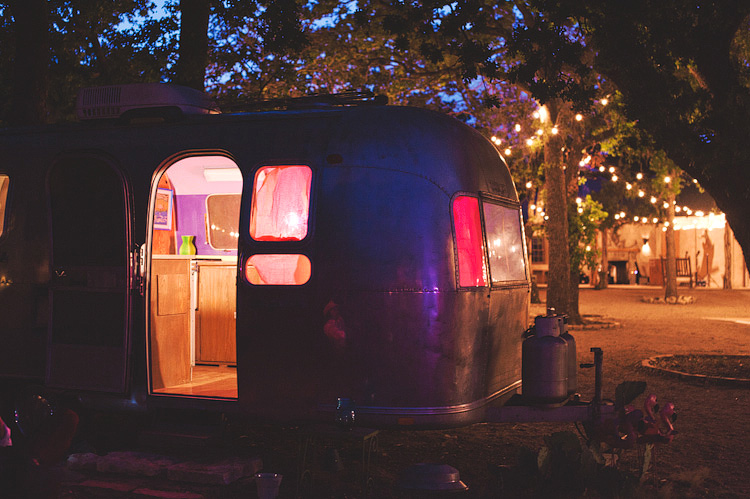 airstream silver trailers at wedding at night