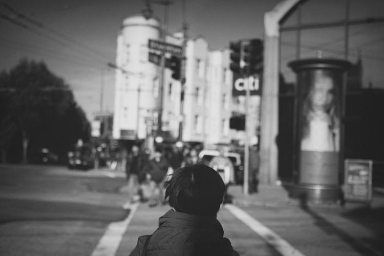 lady walking black and white san francisco
