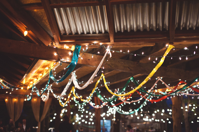 streamers and christmas lights at a wedding