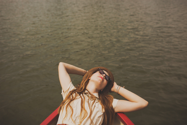 girl lying on boat in Versailles