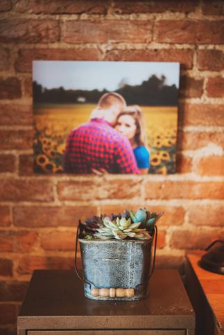 wood prints hung on brick wall
