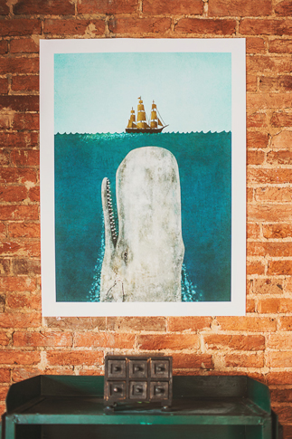 print of whale on brick wall