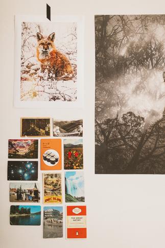 postcards hung on wall
