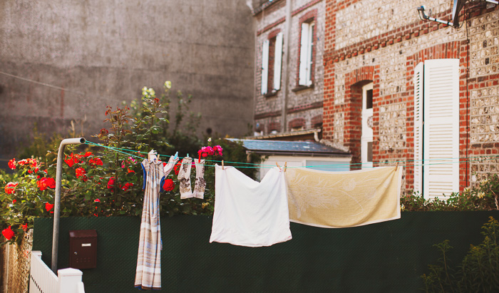 clothing hanging on a line in france 11
