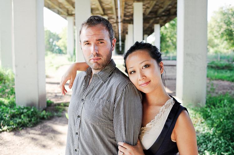 couple standing under bridge engagement photos dc