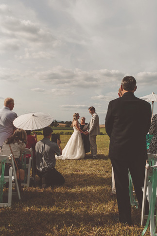 nessa k 18 parasols at ceremony site  Farm Wedding in Frederick MD: Katy and Parkers Backyard