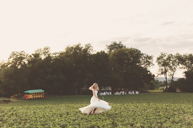 nessa k 31 bride twirling in a field  Farm Wedding in Frederick MD: Katy and Parkers Backyard
