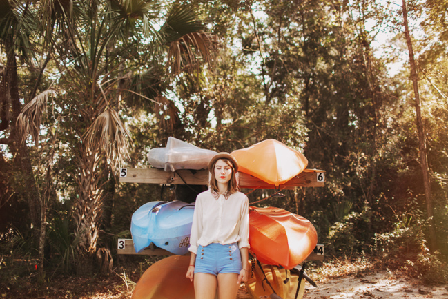 girl in front of colorful canoes1