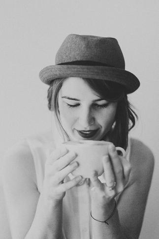 black and white girl sipping coffee