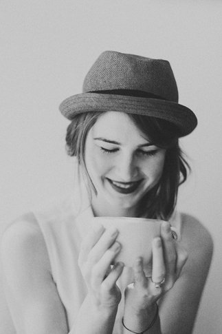 girl sipping coffee black and white