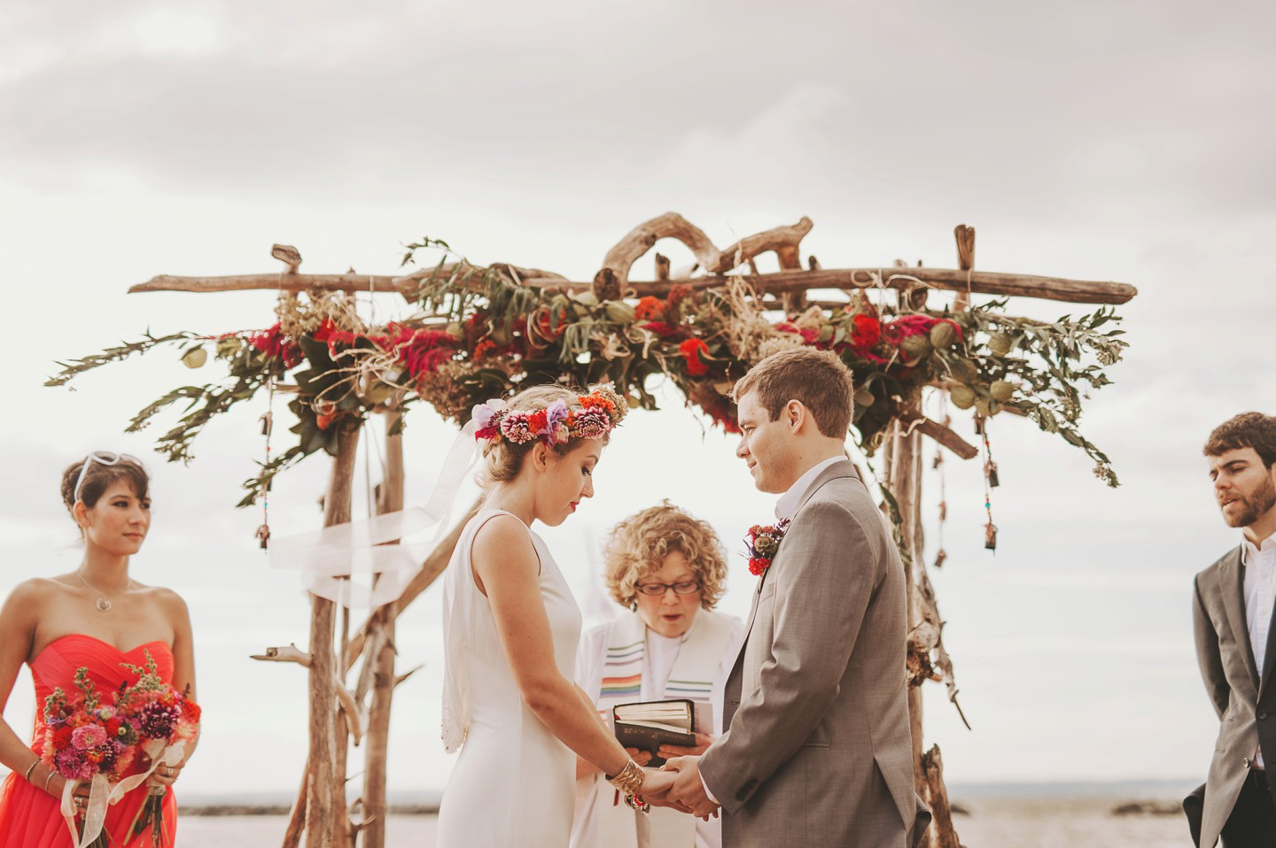 maryland beach wedding under flowers