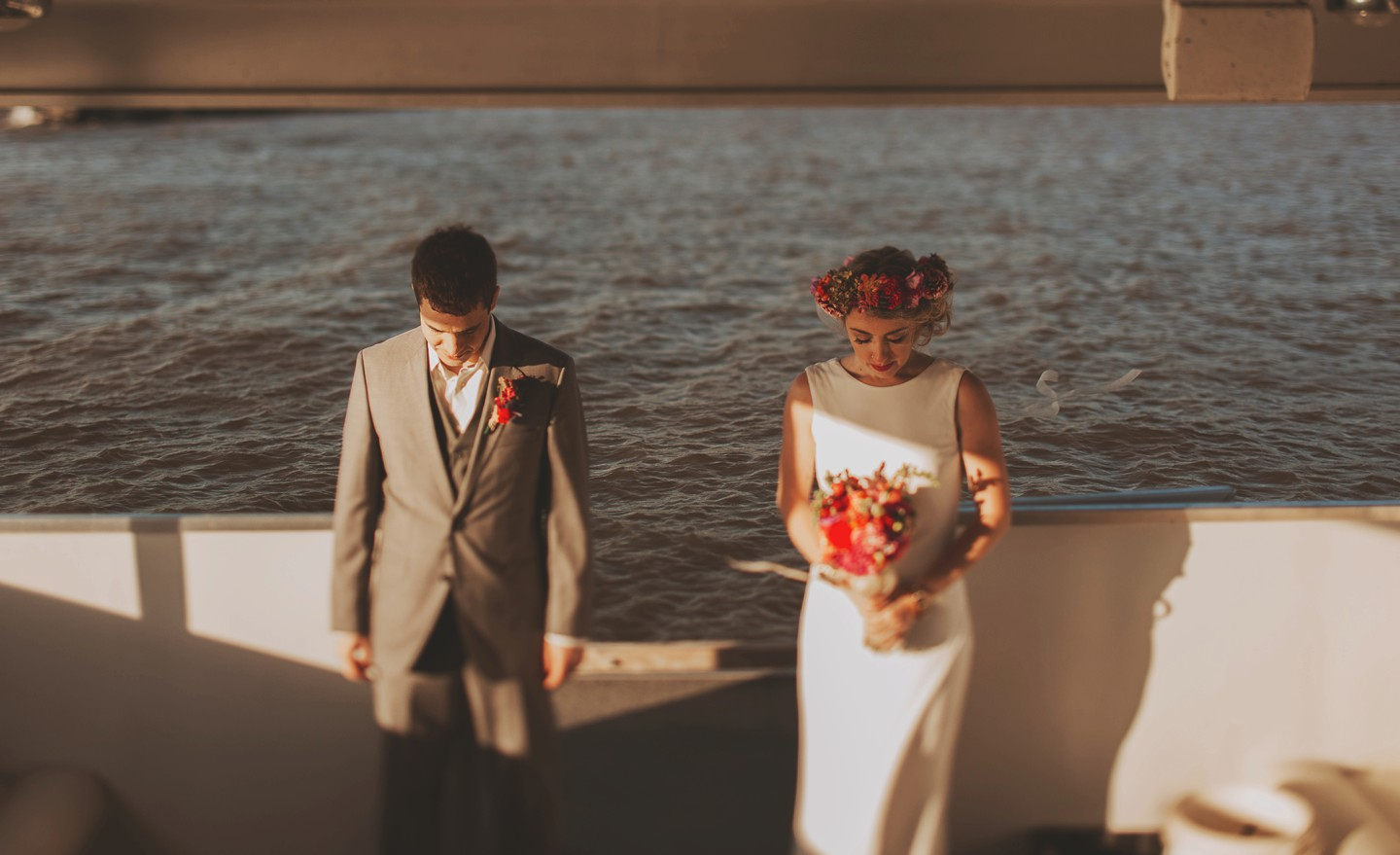 artistic portrait on boat of bride and groom