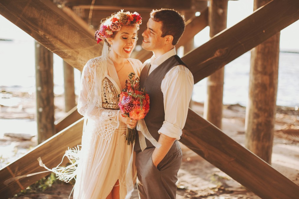 beautiful bride and groom portrait under dock