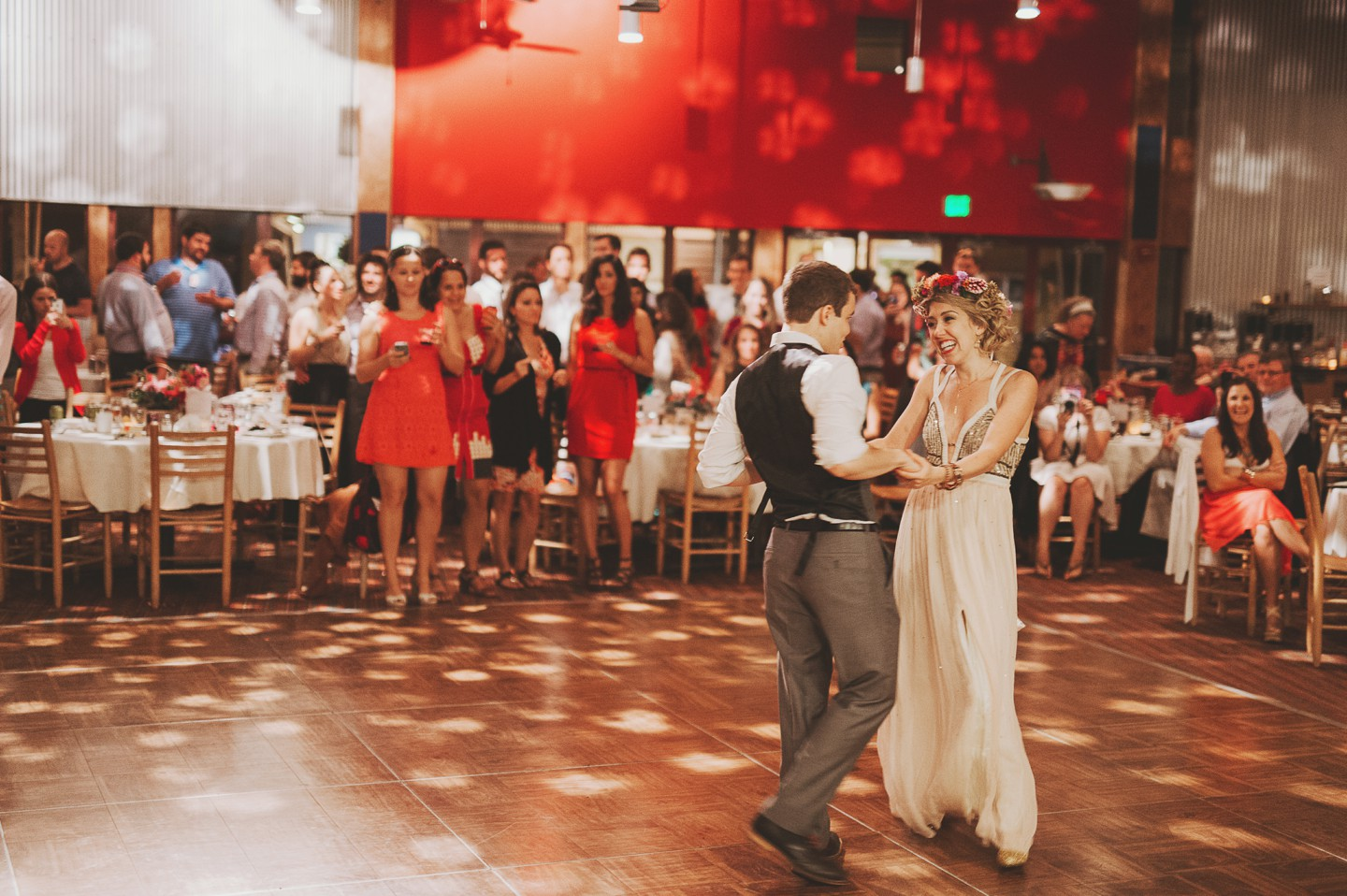 bride and groom dancing under a dance ball