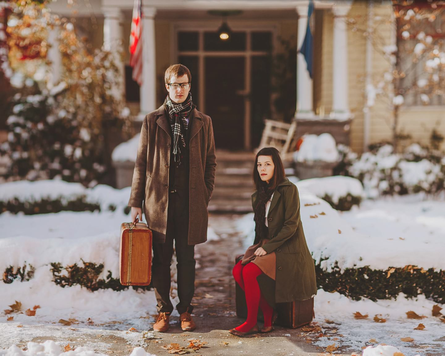 suitcase and snow engagement pictures