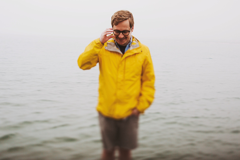 foggy becah photos yellow rain jacket
