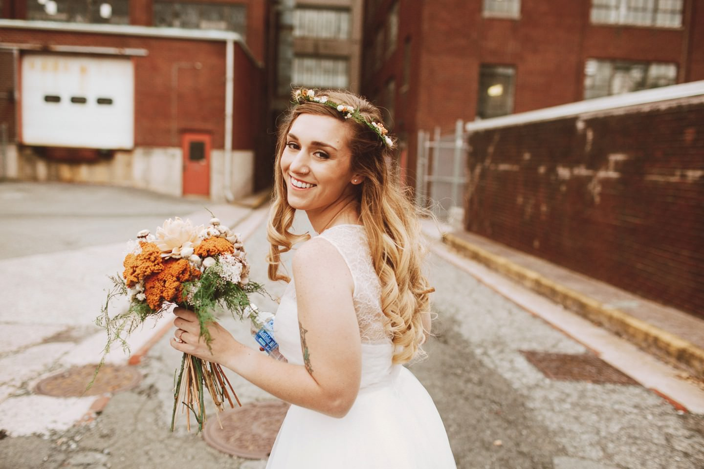 smiling bride with orange flowers