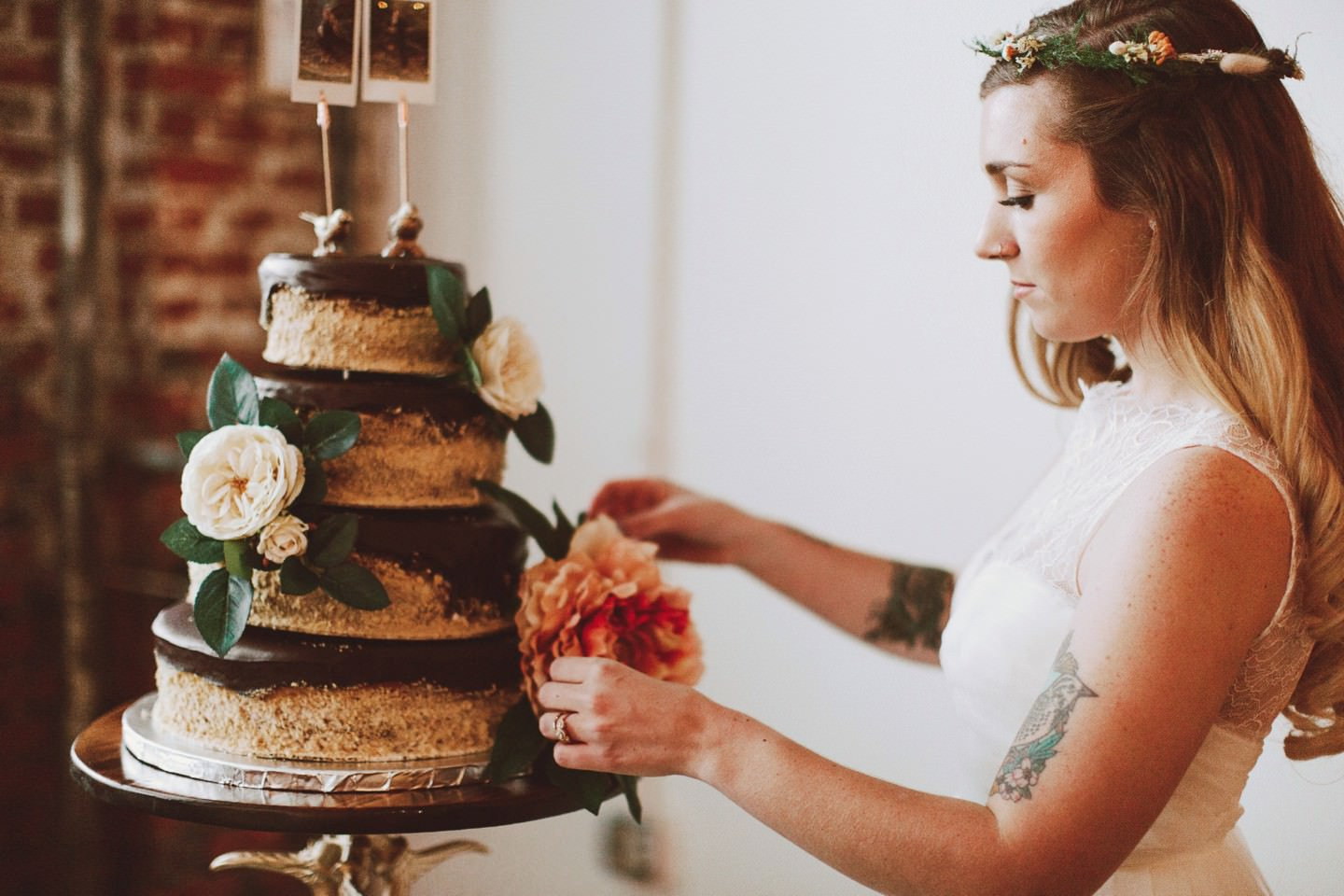 bride decorating her own cake