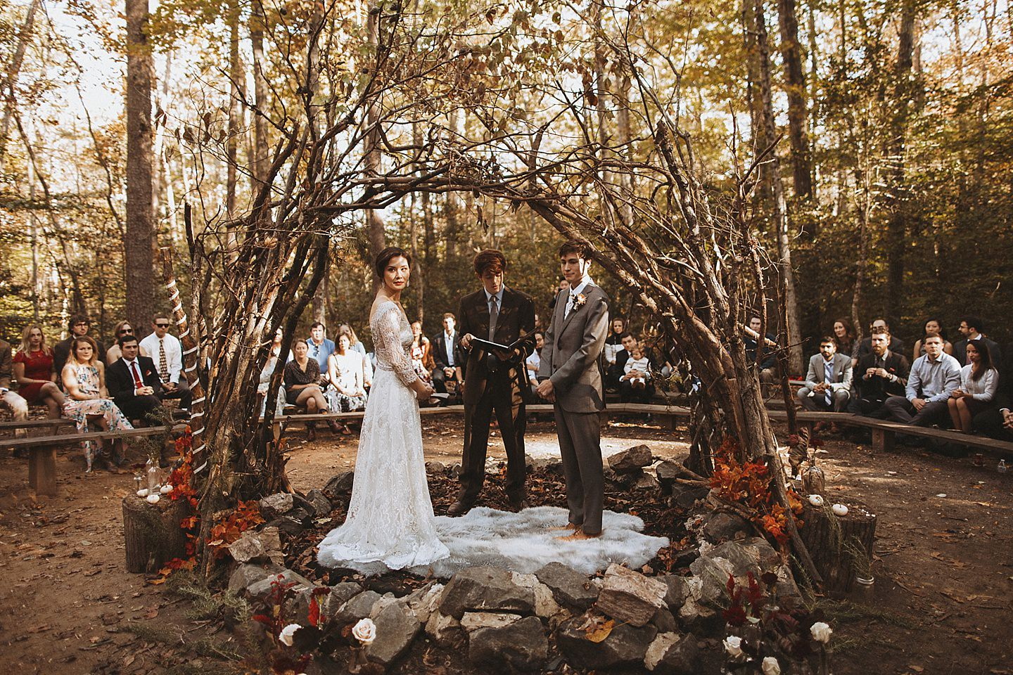 ceremony under beautiful arch at camp happyland